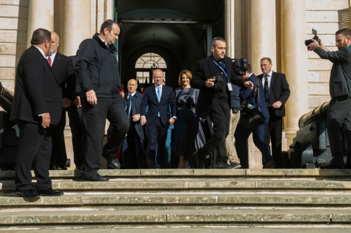 Joseph Muscat exiting Castille for the last time, accompanied by his wife Michelle Muscat