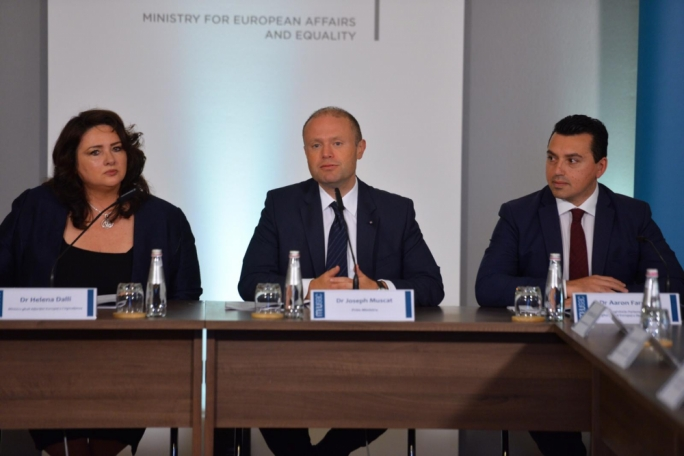 Joseph Muscat flanked by European Affairs Minister Helena Dalli and EU funds Parliamentary Secretary Aaron Farrugia, addressing social partners at MEUSAC. Photo: James Bianchi/MediaToday)
