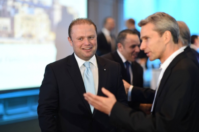 Joseph Muscat with Henley's Christian Kalin (foreground) at a Henley & Partners conference in Malta. Photo: Ray Attard