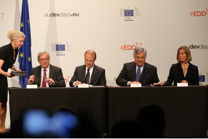 Prime Minister Joseph Muscat signs the European Consensus on Development during a ceremony in Brussels together with European Commission president Jean-Claude Juncker (L), European Commission vice president Federica Mogherini, and European Parliament president Antonio Tajani