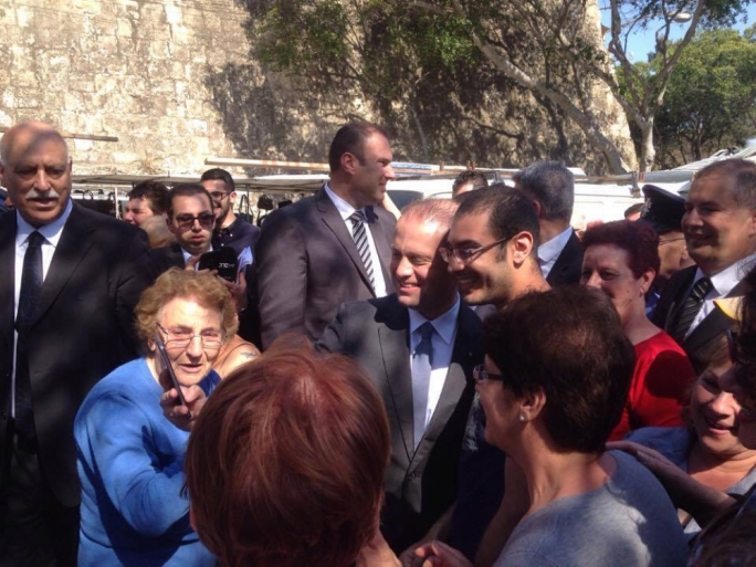 Prime Minister Joseph Muscat takes photos with Labour Party supporters at Birgu Market (Photo: Yannick Pace/MediaToday)