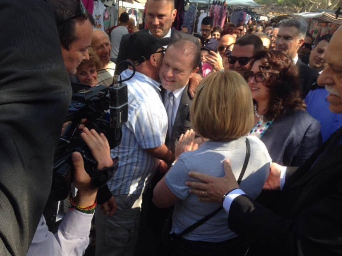 Labour leader Joseph Muscat greeted warmly at the Birgu market (Photo: Yannick Pace/MediaToday)