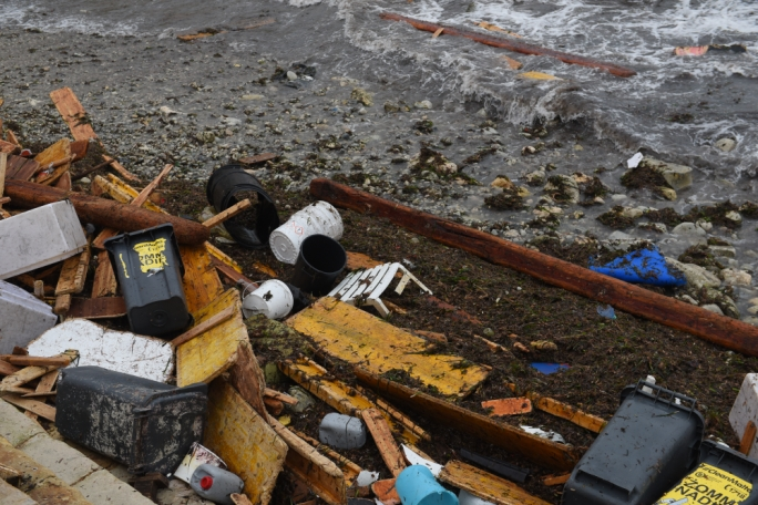 At Balluta Bay, scores of waste (mostly plastic and wood) was being carried out to sea