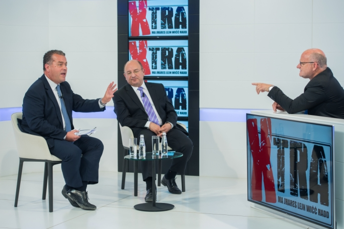 Nationalist MP Beppe Fenech Adami (left) and Home Affairs Minister Michael Farrugia (centre) on Xtra tonight
