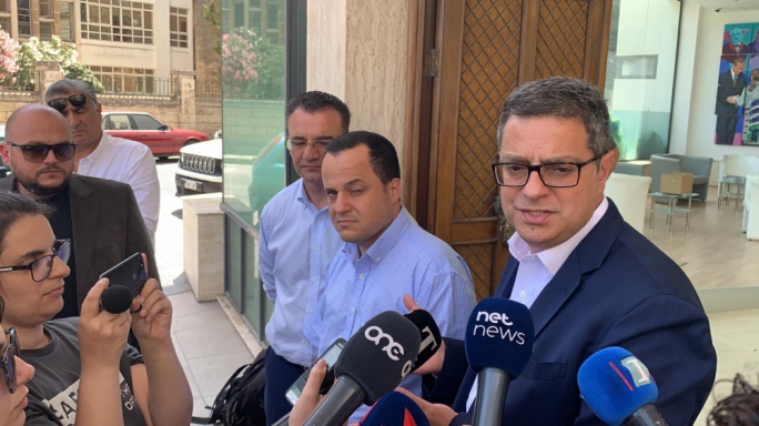 Kevin Cutajar (centre) with PN leader Adrian Delia