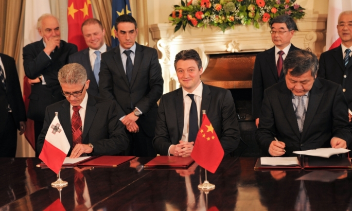 A beaming Konrad Mizzi presides over the signing of the Chinese equity investment in Enemalta in 2014 (Photo: Chris Mangion)