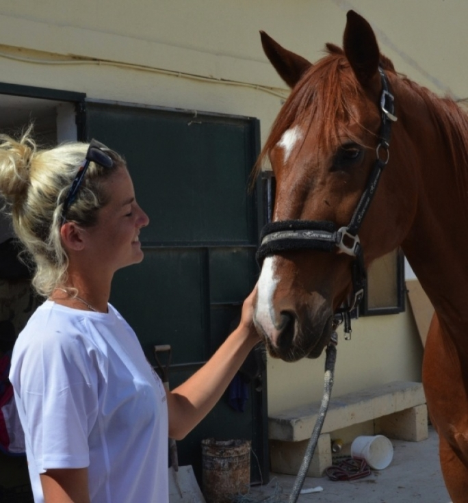 Korin Farrugia with Tiny, one of the horses rescued by RMJ