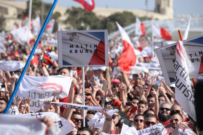 People are sporting placards with the words 'Proud Maltese' (Photo: James Bianchi/MediaToday)