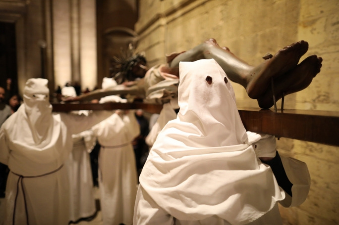 Penitents carry the large crucifix during the Black Procession
