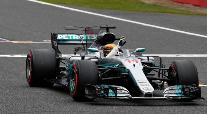 Lewis Hamilton (GBR) Mercedes-Benz F1 W08 Hybrid celebrates in parc ferme at Formula One World Championship, Rd16, Japanese Grand Prix, Qualifying, Suzuka, Japan,