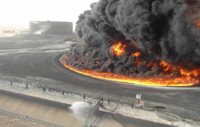 Seven of the 19 oil tanks at Al-Sidra were ablaze on Sunday as a result of the fighting.