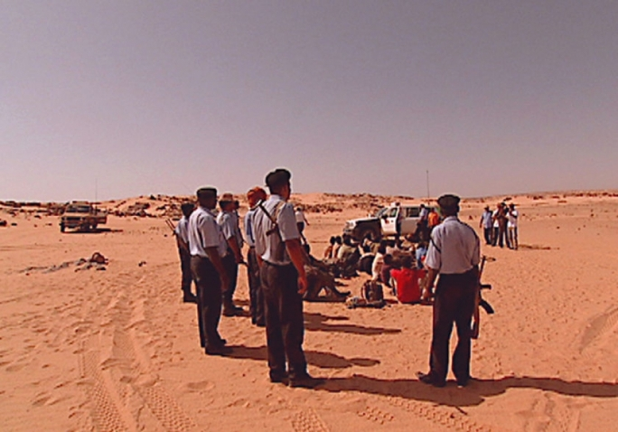 Refugees travelling from Ghana are caught in the Sahara Desert by the Libyan border patrol