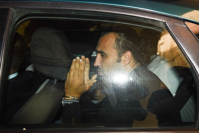 One of the Libyan men accused with murder being escorted into court. (Photo: James Bianchi/MediaToday)