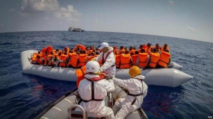 Migrants' unsafe sea crossings top record 100,000 mark in July