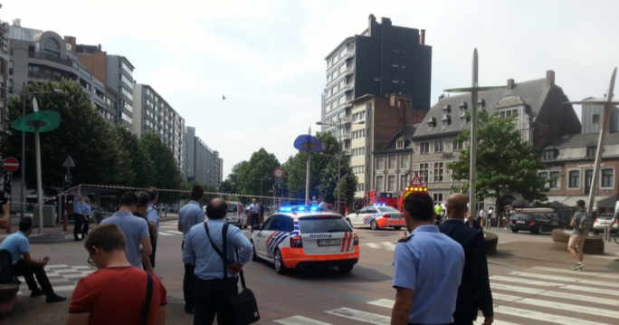 A gunman has shot two police officers and a passer-by in Liege, Belgium