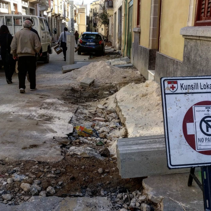 A third photo submitted by BAG shows a busy street in Birkirkara with extensive damage to a pavement that is still going through maintenance, preventing pedestrians from using it