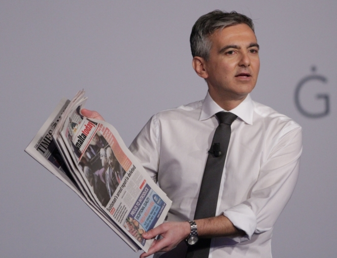 PN leader Simon Busuttil holds a copy of MaltaToday. Photo: PN