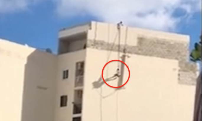 An eyewitness saw the man hanging onto a rope and trying to climb back up minutes before he plunged to his death