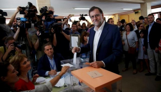 Spain's acting prime minister and People's Party leader Mariano Rajoy casts his vote