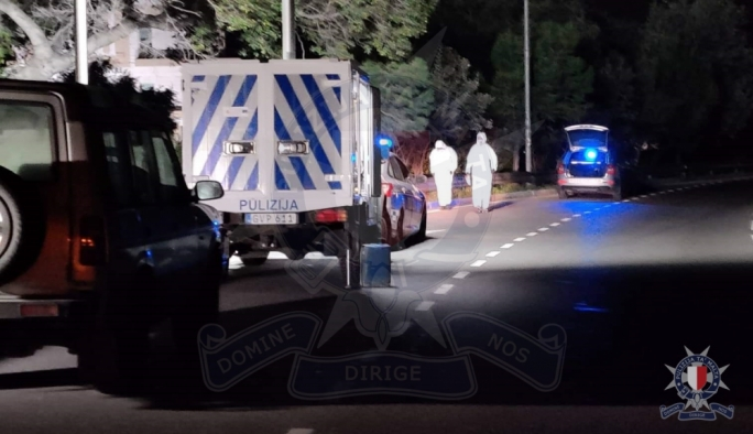 The man was found dead by police on the side of the busy road
