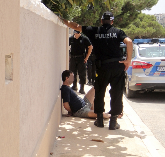 The 44-year-old suspect handcuffed and arrested by the RIU police. Photo JohnPisani