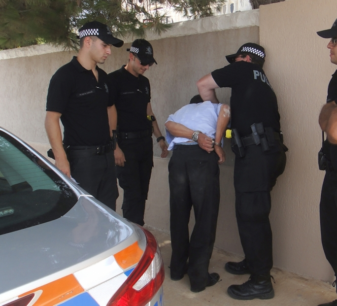 RIU police arresting one of the suspects. Photo JohnPisani
