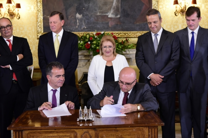 President Marie Louise Coleiro Preca looks on as Carmelo Briffa, secretary to the presidency, and Fundacion Mapfre managing director Pablo Jimenez sign the memorandum of understanding