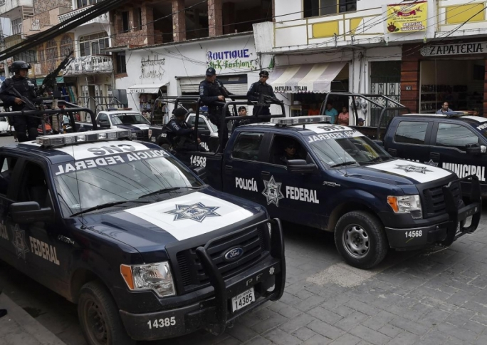 Mexico federal police chief fired over Michoacan ranch killings