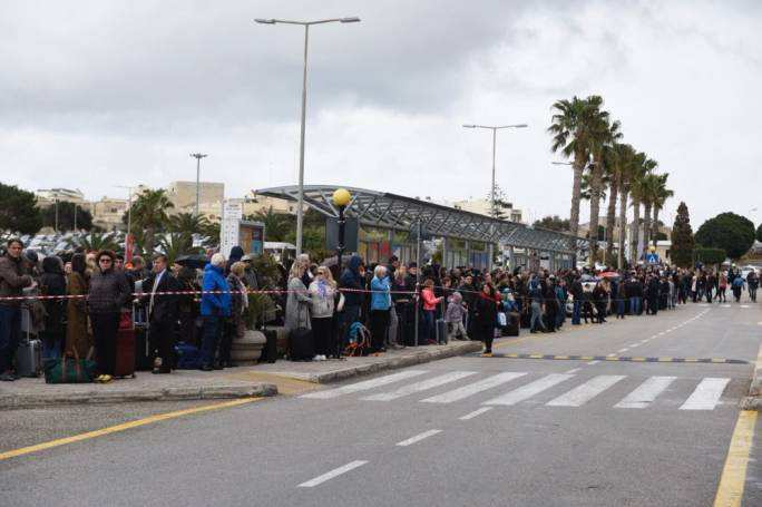 Passengers stood outside the terminal while the small fire was put out