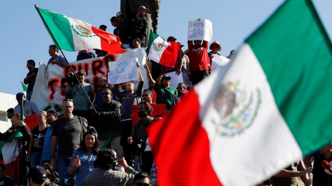 Protesters march against migrant caravan in Tijuana