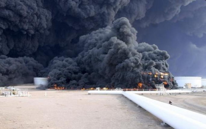 Seven of the 19 oil tanks at Al-Sidra were ablaze on Sunday as a result of the fighting