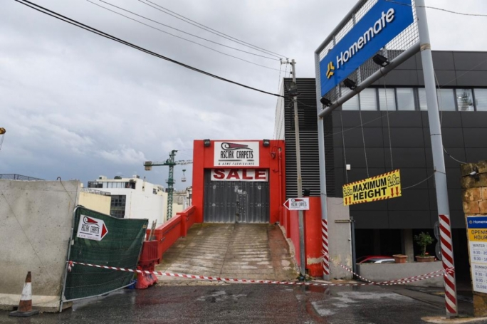 Police have cordoned off the entrances to Asciak Carpets and Homemate (Photo: James Bianchi/MediaToday)