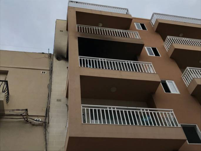Last Sunday, a man died while trying to put out the flames in the apartment below his in Marsaskala