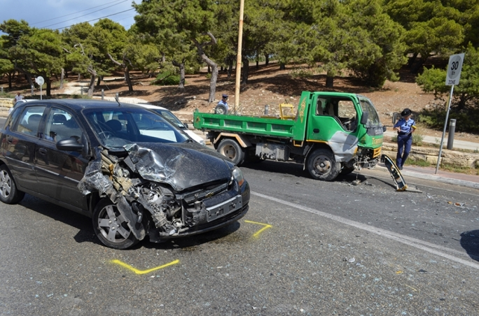 The car and the truck involved in the accident. Photo John Pisani