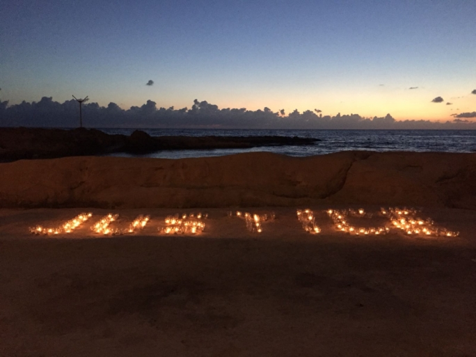 Candles placed on the Sliema beach in memory of Daphne Caruana Galizia