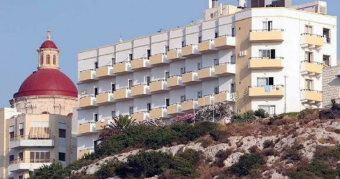 The Panorama Hotel was built in the 1960s on a ridge overlooking Għadira Bay