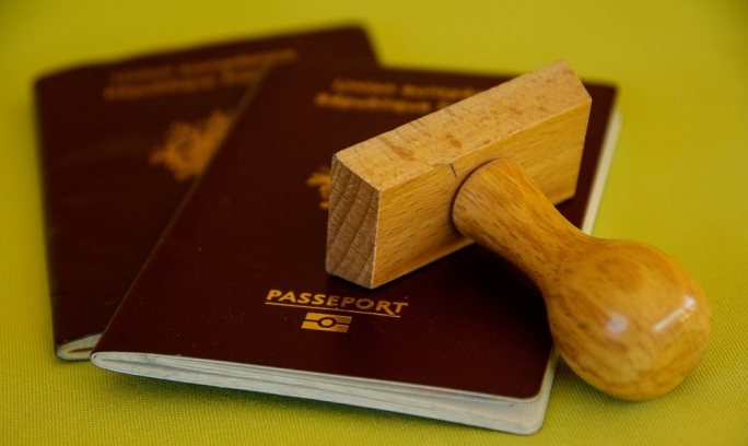 Nine jailed for using false passports