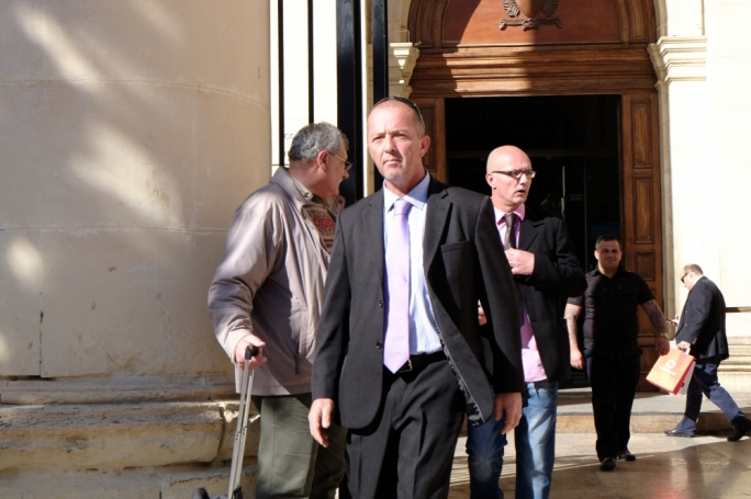 Paul Sheehan (front) leaving court in a previous sitting. The shooting incident happened in 2014 after a drunk-driver clipped a ministerial vehicle that Sheehan was responsible for.