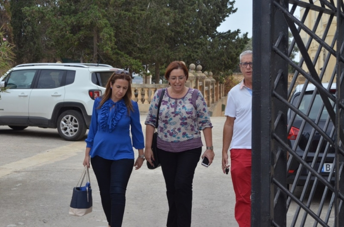 Paula Mifsud Bonnici and Claudette Buttigieg Pace walk to their parked cars after the meeting