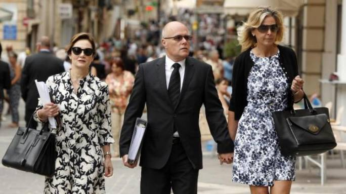 Millionaire Paul Bailey enters court with lawyer Gianella de Marco (left)