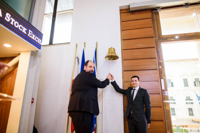 AST Group CEO Mr Emmanouil Kalamaras and Chairman Mr Giuseppe Muscat ring the bell at the Malta Stock Exchange marking the admission of the AST Group plc bond on the Prospects MTF market