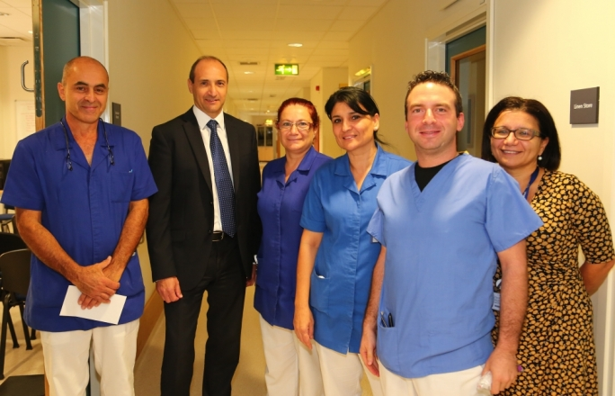 Parliamentary secretary Chris Fearne with members of staff at Mater Dei hospital