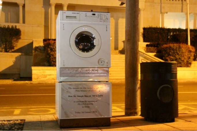 Washing machine stunt outside Pilatus Bank greets employees of arrested chairman