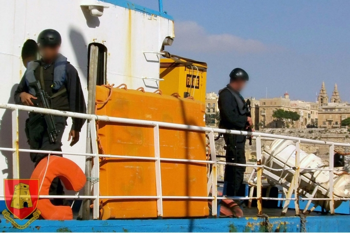 Police searching a vessel for contraband fuel.