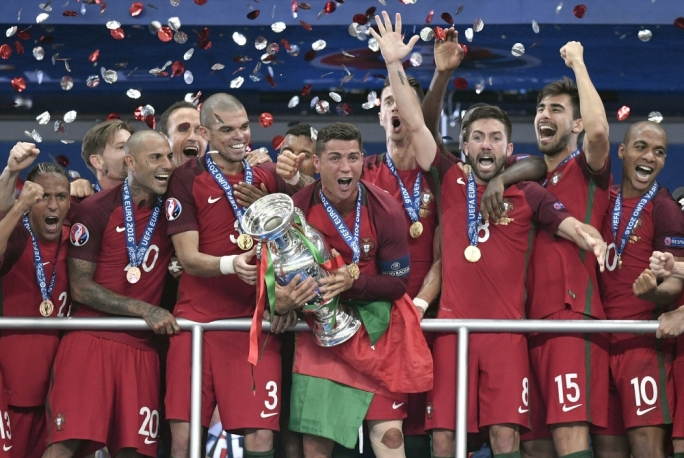 Captain Cristiano Ronaldo holds aloft the Henri Delaunay Trophy after Portugal defeated tournament hosts France to win Euro 2016