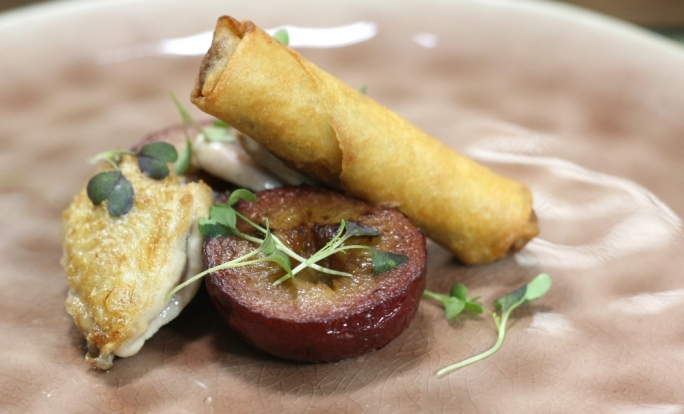 Pan-fried quail breast, spring roll and roasted plums