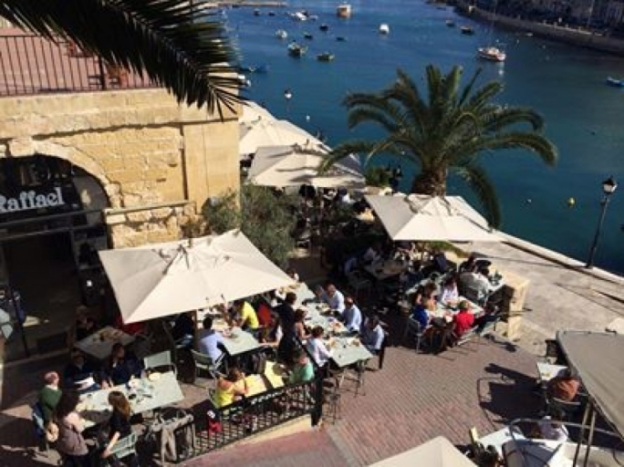 Catch some rays and grab a bite to eat whilst watching the world go by at Raffael in Spinola Bay