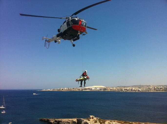 The victim being winched by AFM rescuers. Photo Ray Attard