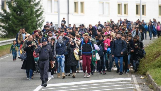(File photo) Refugees walk to the Austrian side of the border crossing Slovenia