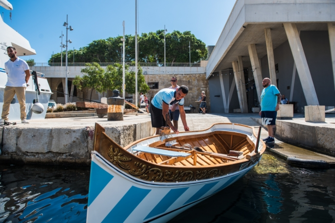 The traditional Regatta boat is launched down a slipway off the new Dock No. 1 in Bormla, and Brignone rows out under the shadow of the gleaming superyachts with Bormla club president Ivan Buttigieg, a former rower